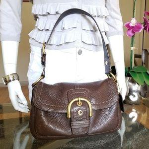 Elegant COACH Leather Purse.